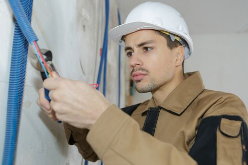 Technician working on a commercial heating system